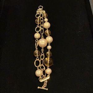 Carolee faux pearl triple strand toggle bracelet